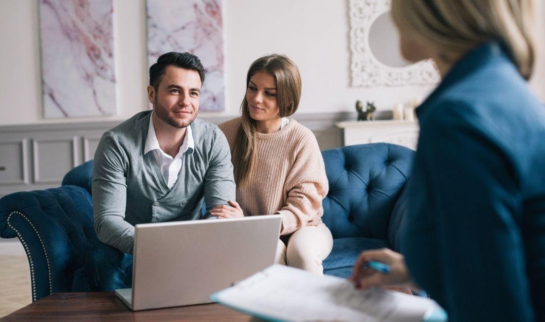 Couple meeting with life insurance advisor