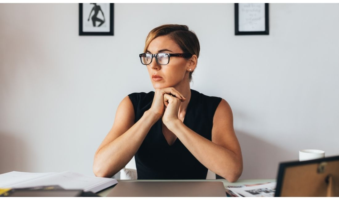Woman thinking at her desk