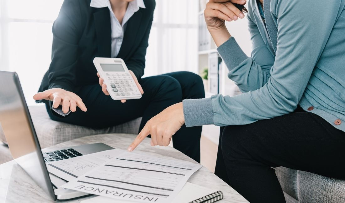 Insurance agent calculating insurance price