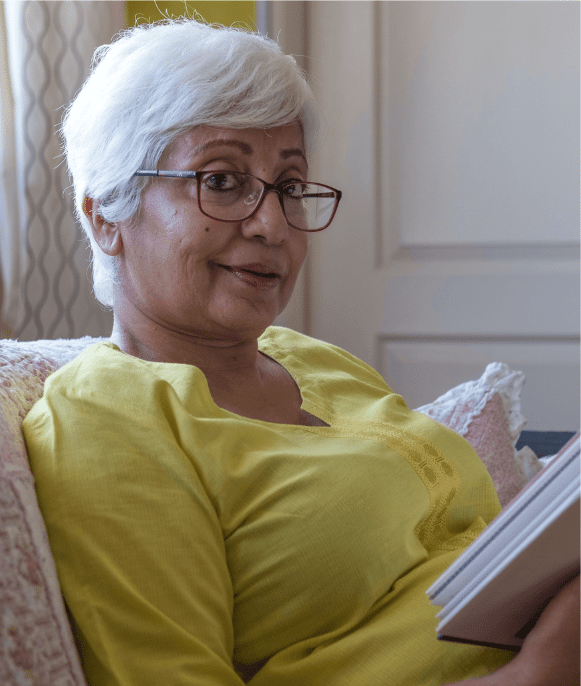 Older woman holding a book