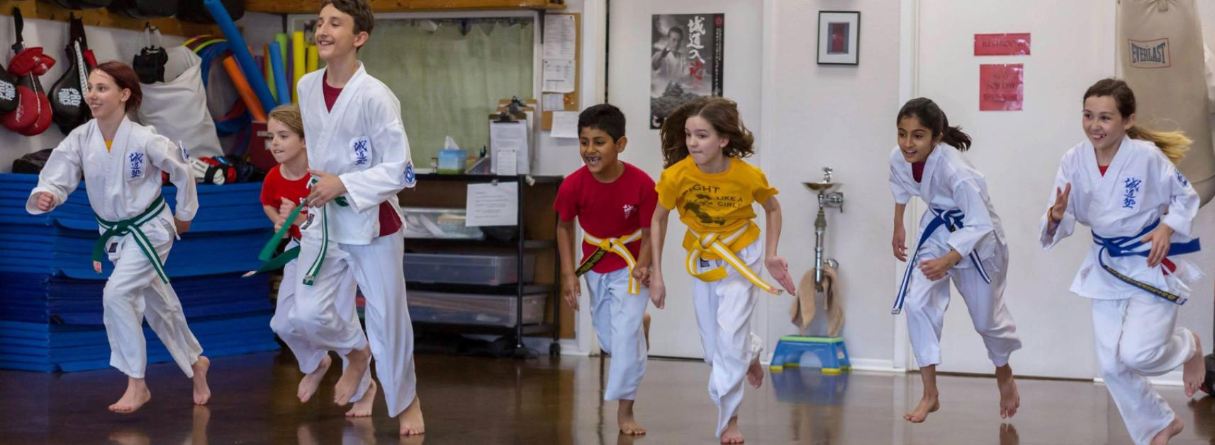 kids running in the dojo