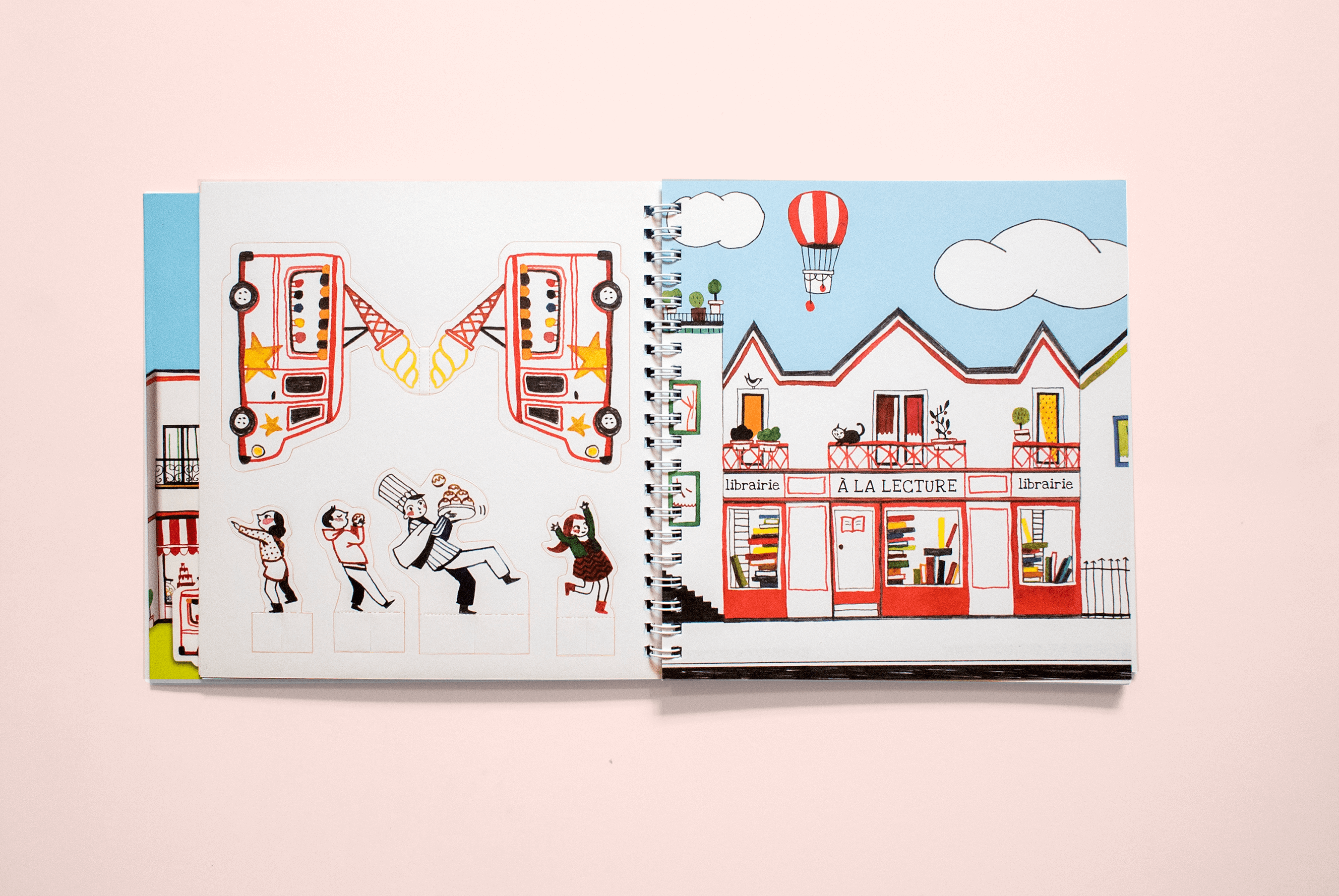 Kids' book open on an illustration of a colourful bookshop