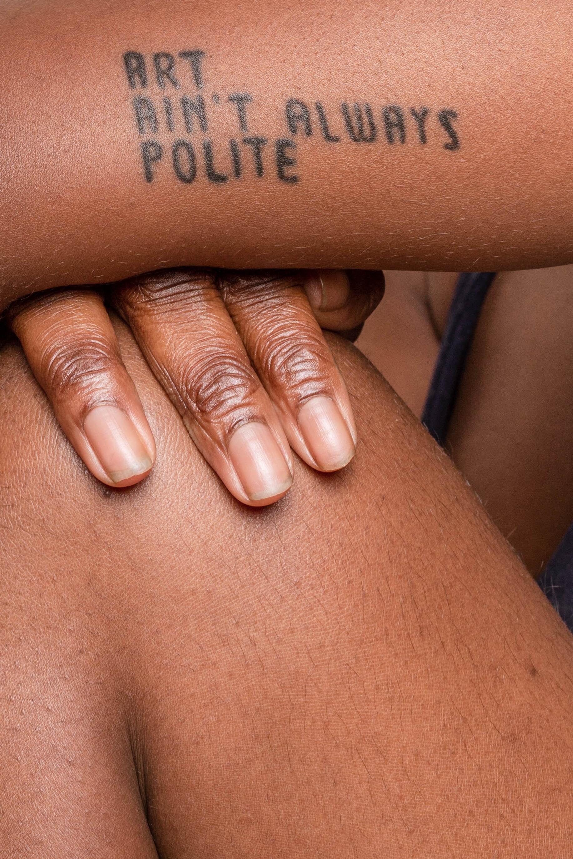 black woman wth tattoo of art ain't always polite
