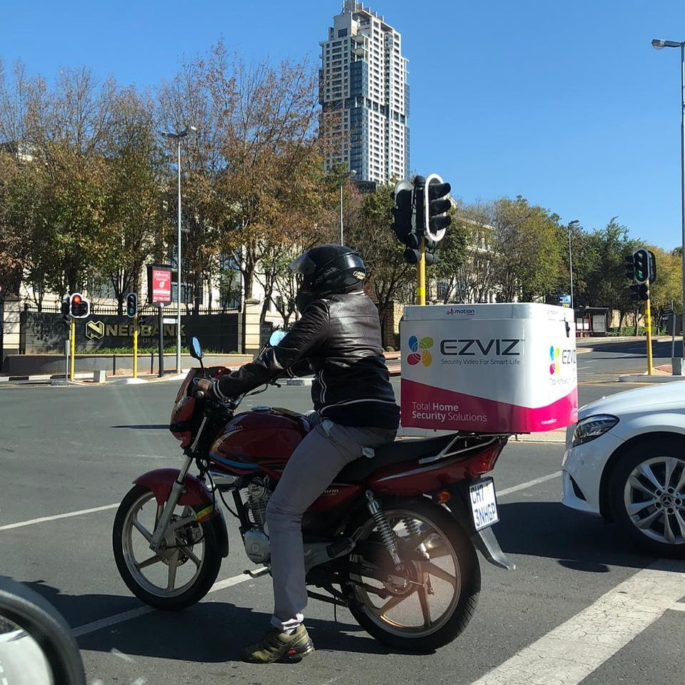 Driver on a bike branded by MotionAds