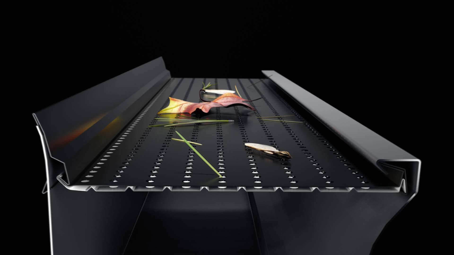 Protège-gouttière Alurex Double Pro avec débris végétaux bloqués sur le dessus