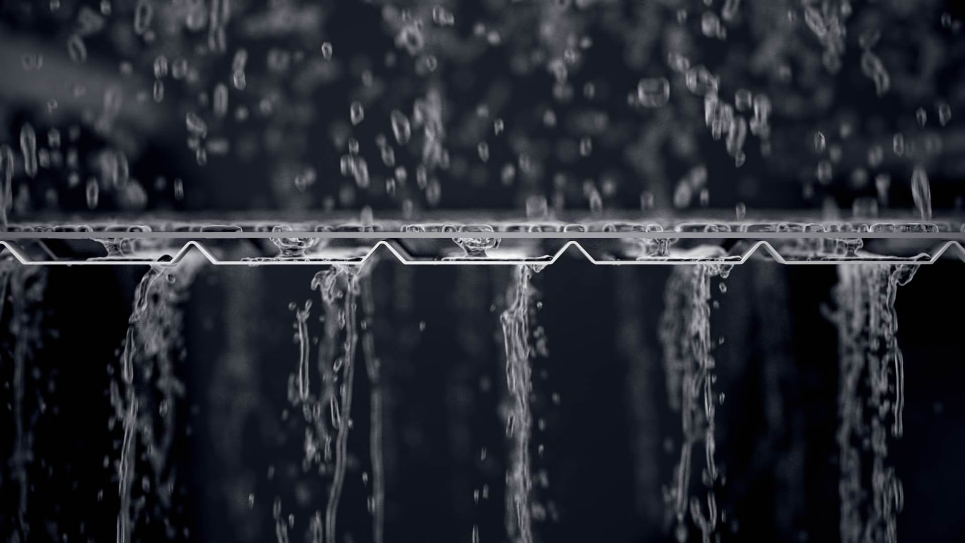 Écoulement de l'eau à travers un protège-gouttière Alurex Double Pro