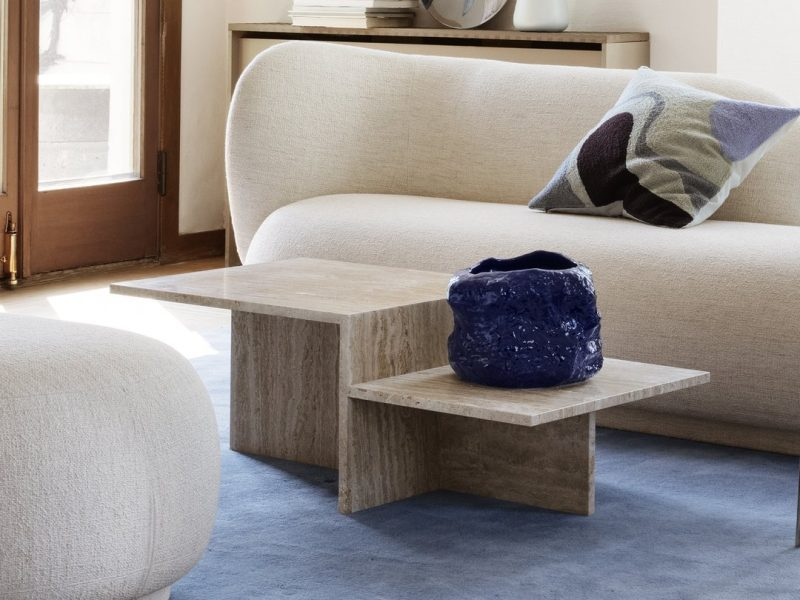 Distinct coffee table by fermLiving in a living room with a beige curvy sofa