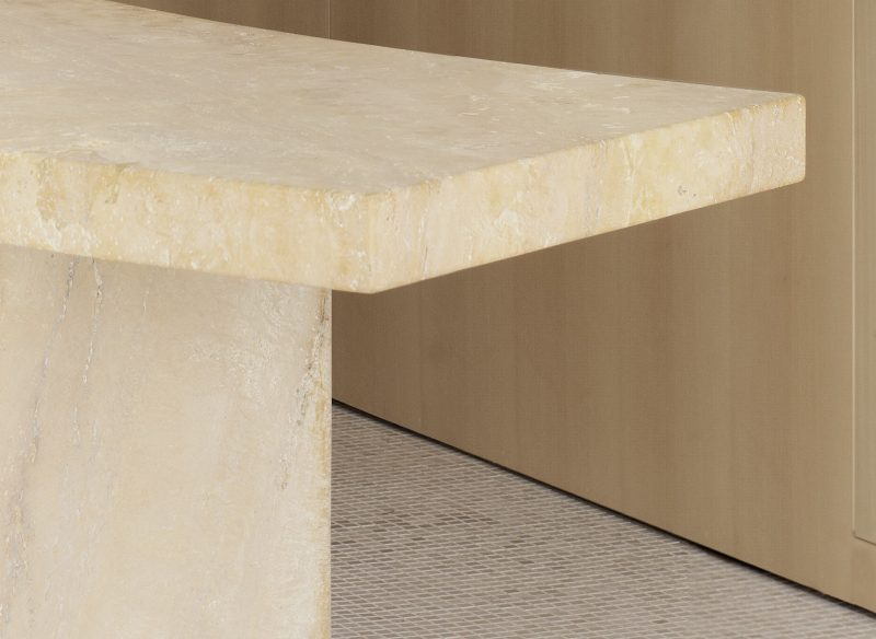 Detail of the travertine console table designed by Interior of the Toteme flagship store in Stockholm with a travertine table, designed by Christian Halleröd