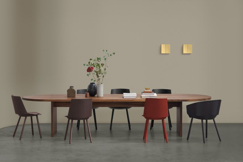 The large oval Ashida conference table by e15 in a setting with wooden dining chairs