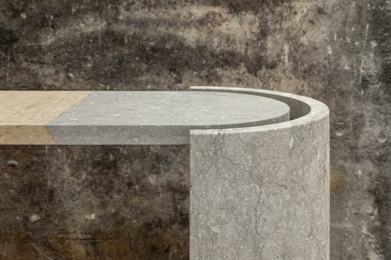 Detail of the oval shaped, grey-beige Bicolore stone side table