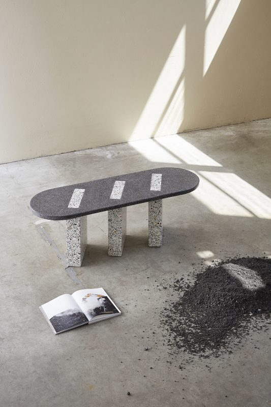 Grey and black Bottom Ash terrazzo-style console table by Carissa Tentije in a warehouse