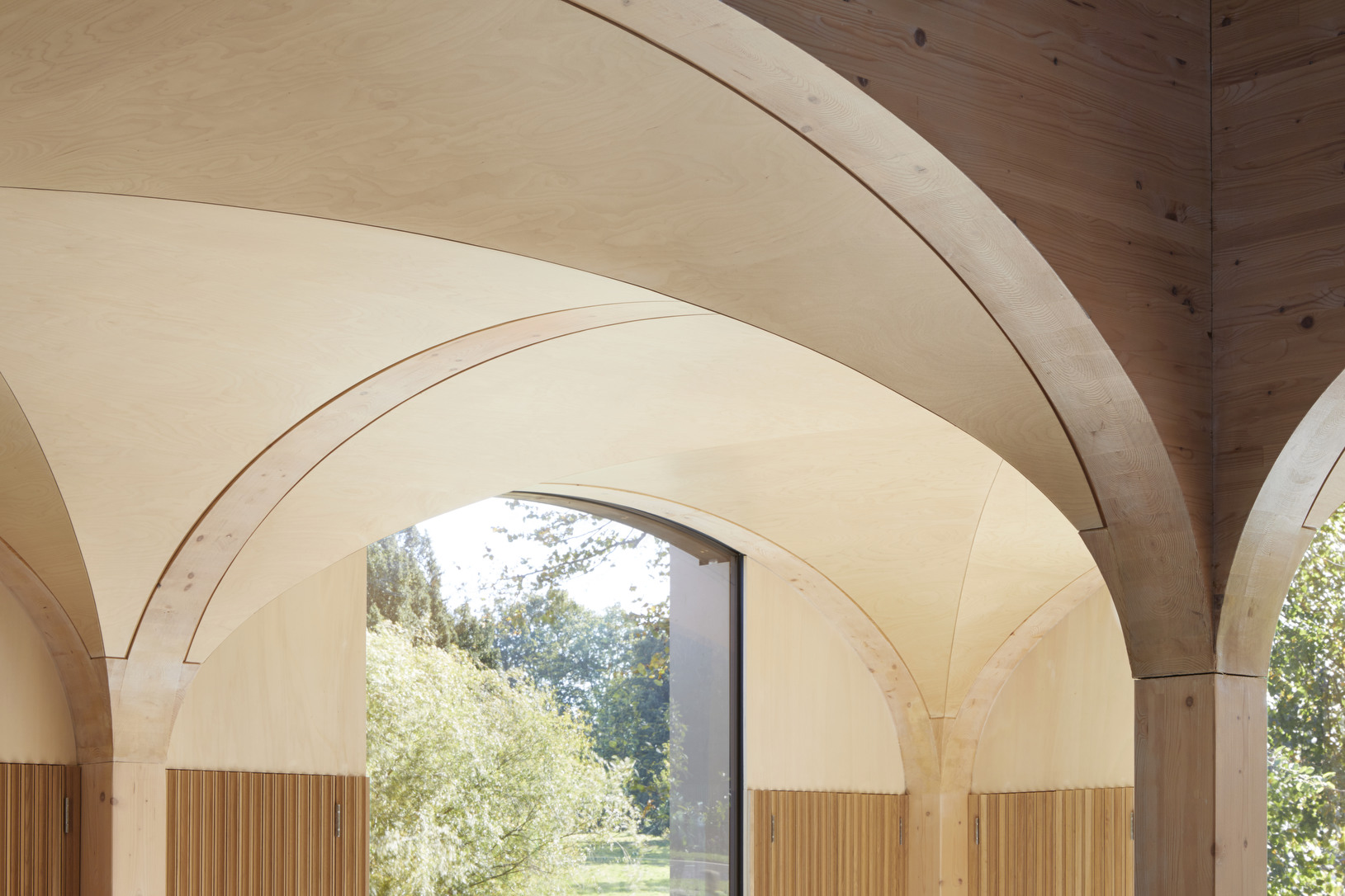 Arched ceilings panelled with bright wood in the Wildernesse Restaurant