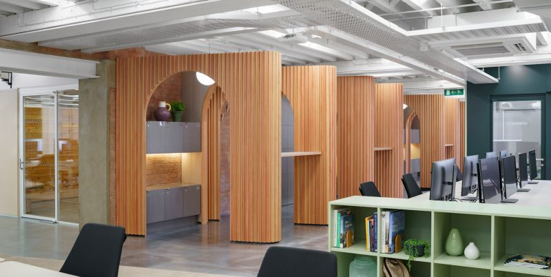 Arched wood panells forming a stoa in the London Airbnb office