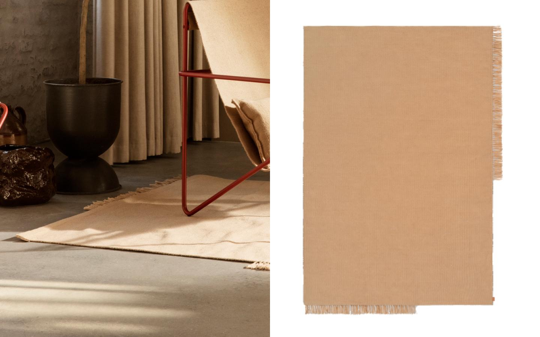 Beige rug with asymmetric fringe border
