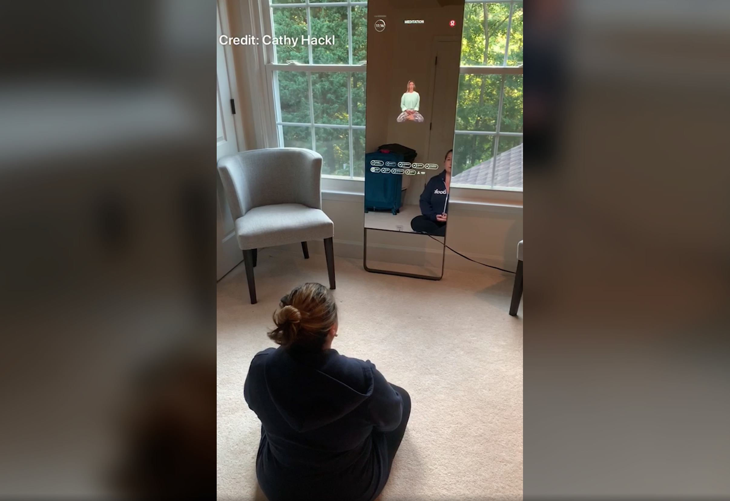 screenshot of cathy hackl sitting in front of a smart mirror