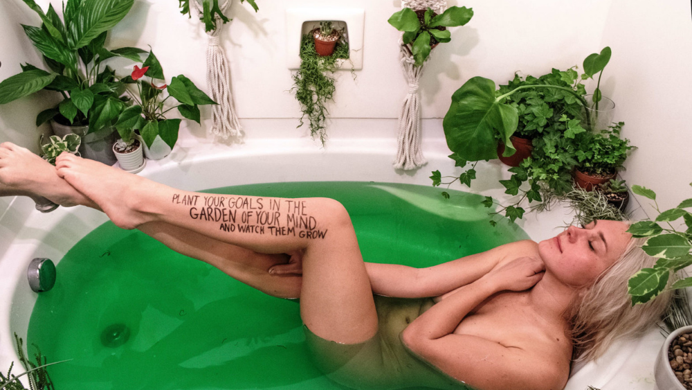 Female Disruptors Skin On Sundays - Girl in green bathwater with plants surrounding