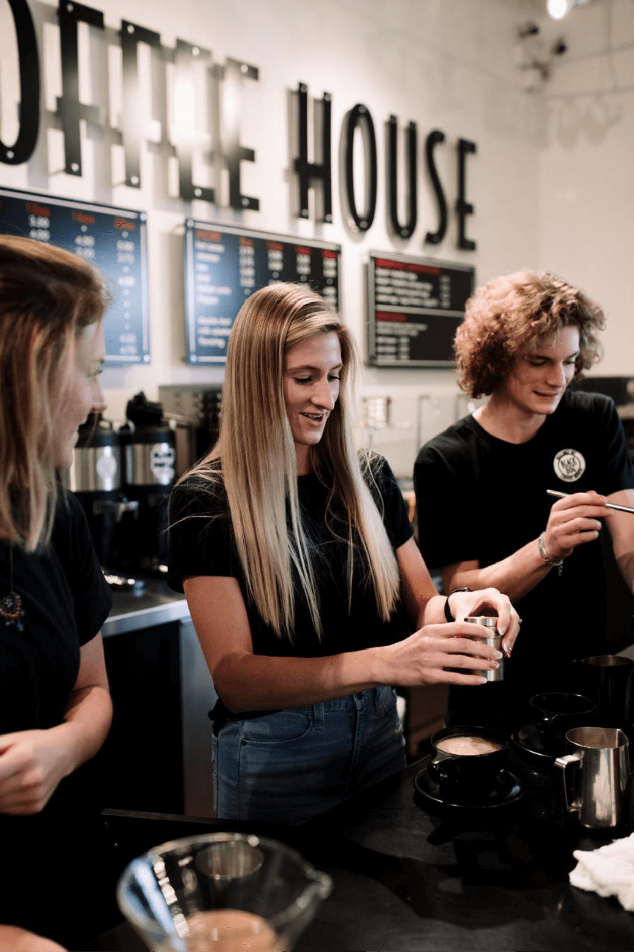 Baristas at espresso machine