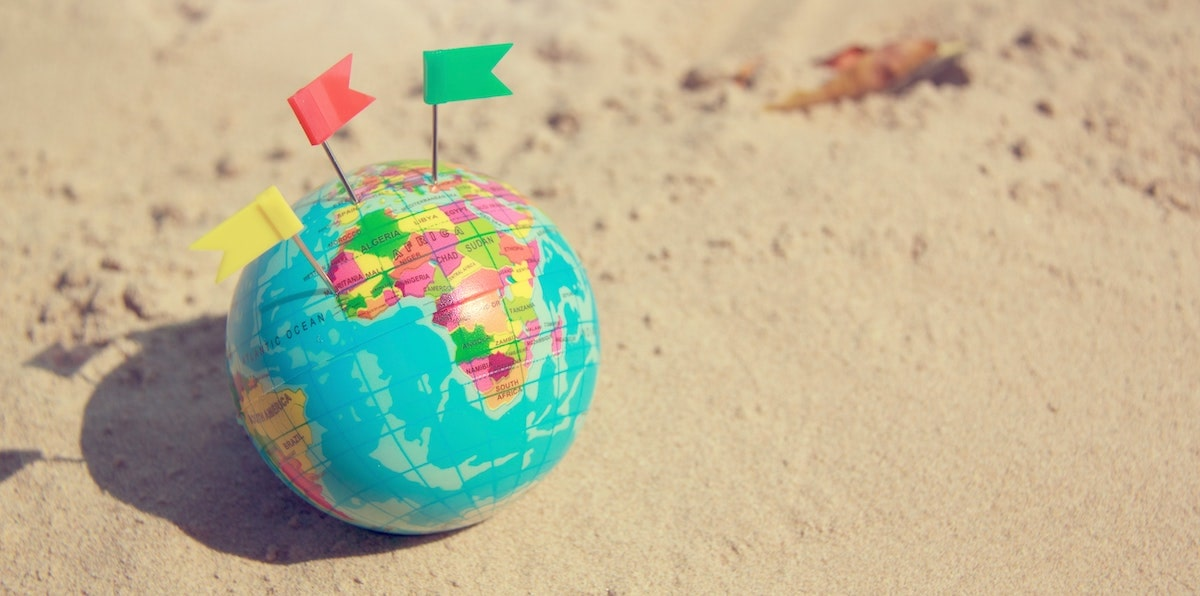 globe figure with flags in it: international SEO and domain strategy