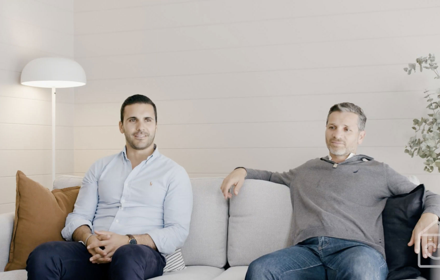 Co-founders Antony and Sam sitting on a couch telling a story