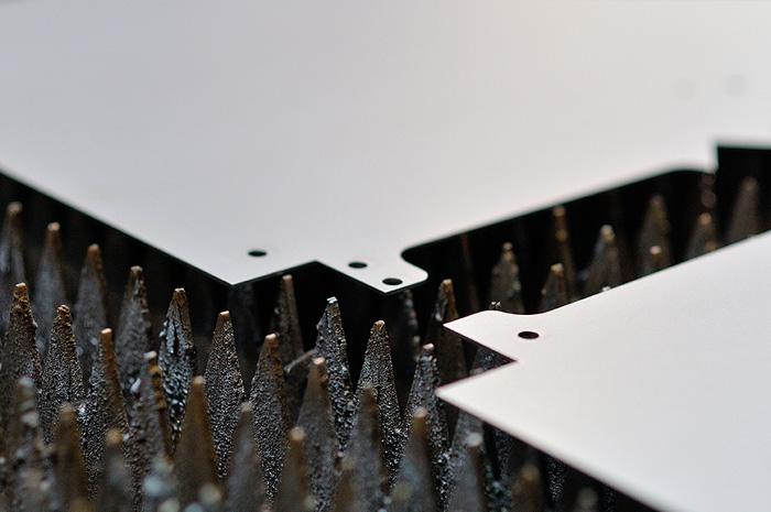 Typische Blechbearbeitung durch Laserschneiden