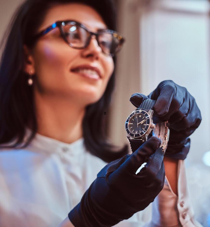 Employee inspecting a luxury watch