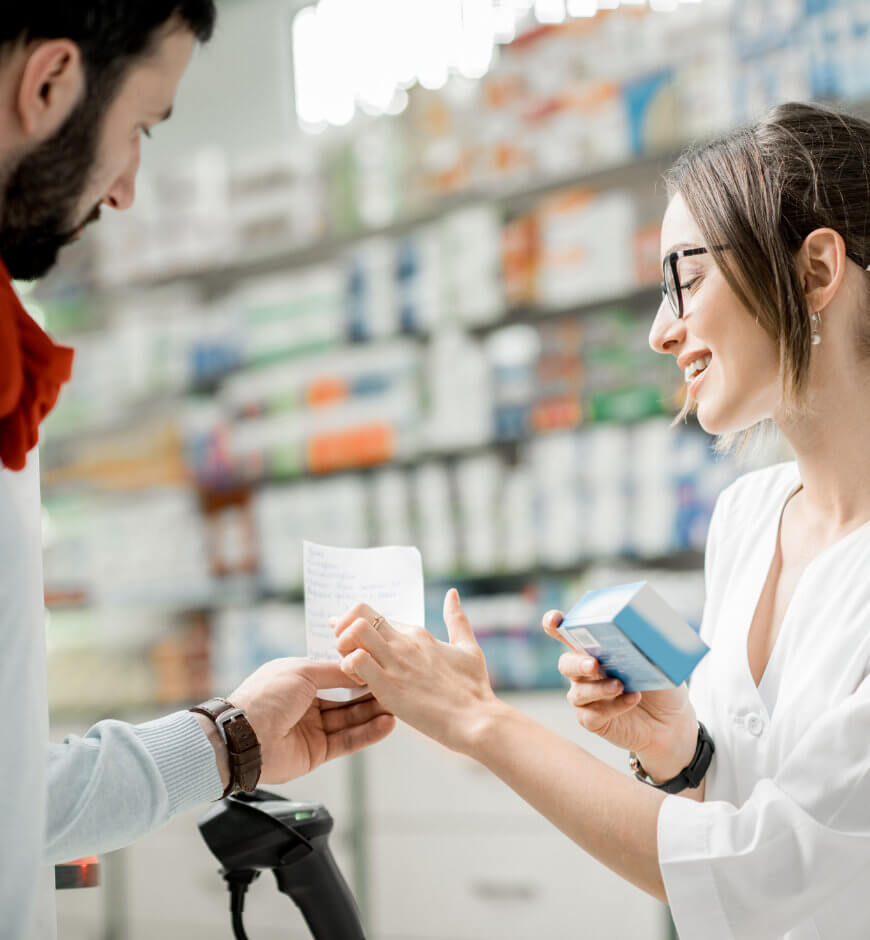 Pharmacist reviewing medications with patient