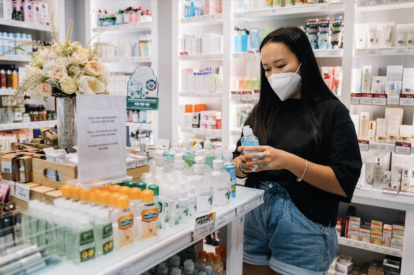 woman wearing a mask shopping in a pharmacy