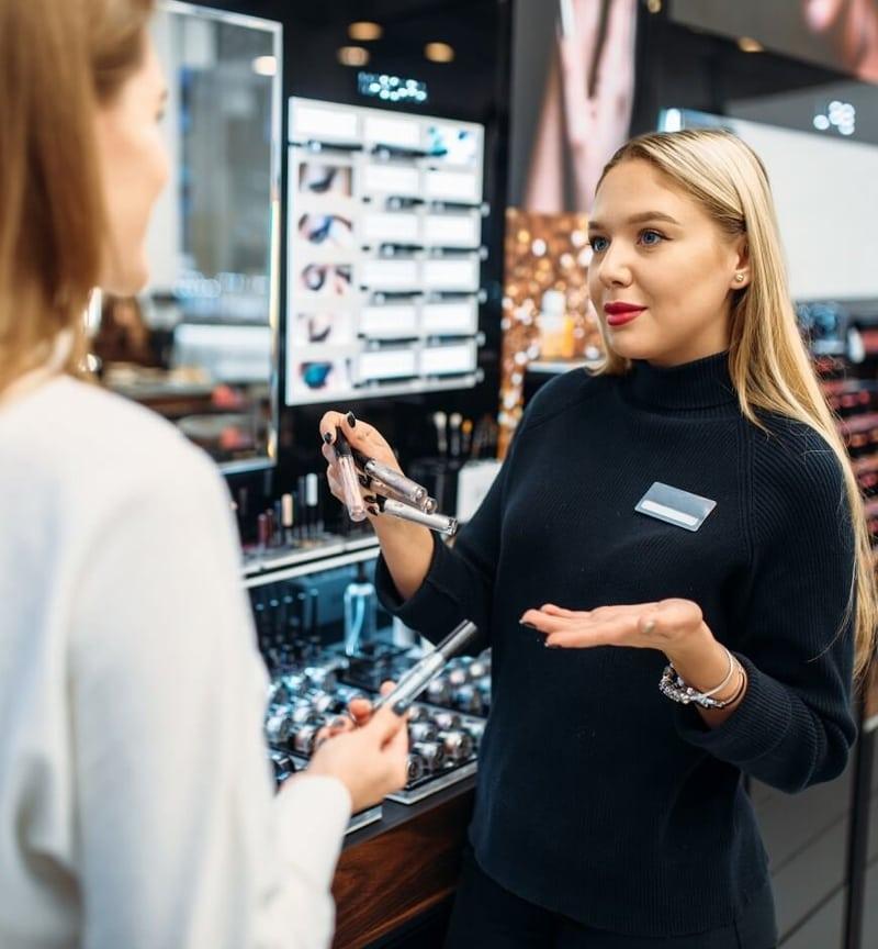 Sales associate selling makeup