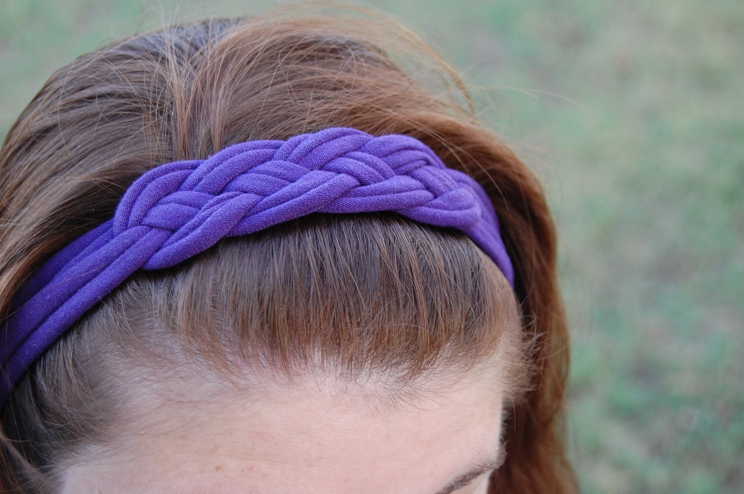 Handmade purple hairband made from an old t-shirt worn by a woman