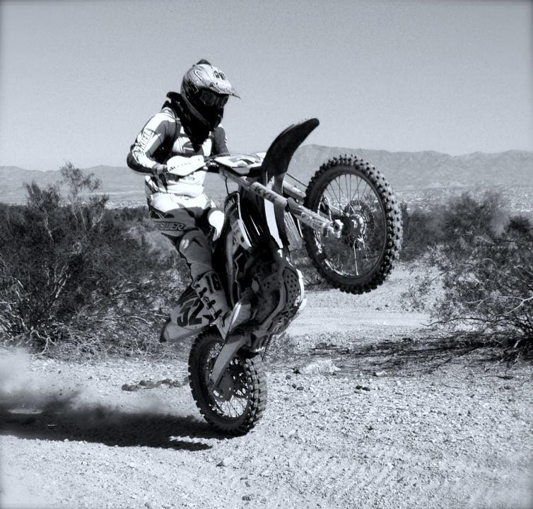 Dr. Dorris riding a dirtbike