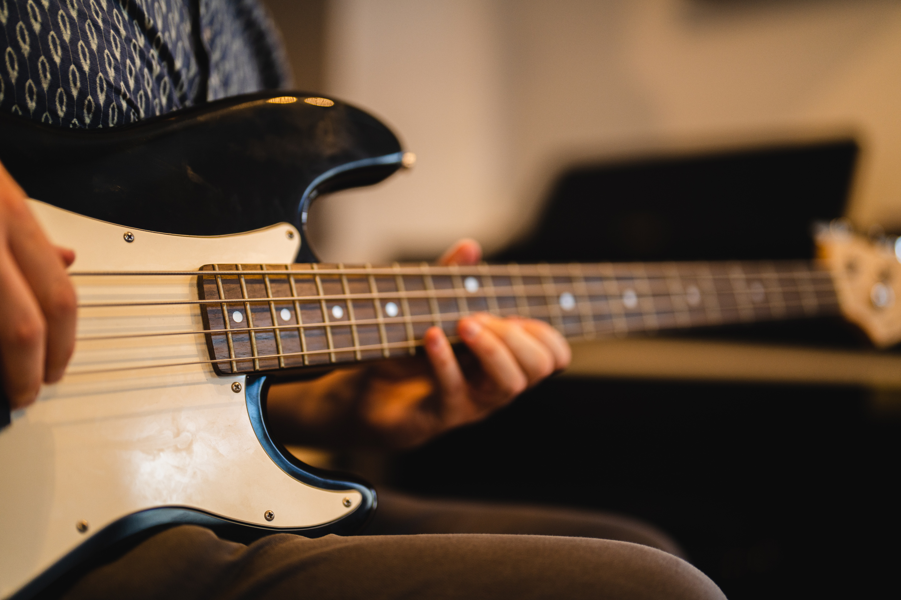 Person playing an electric bass guitar