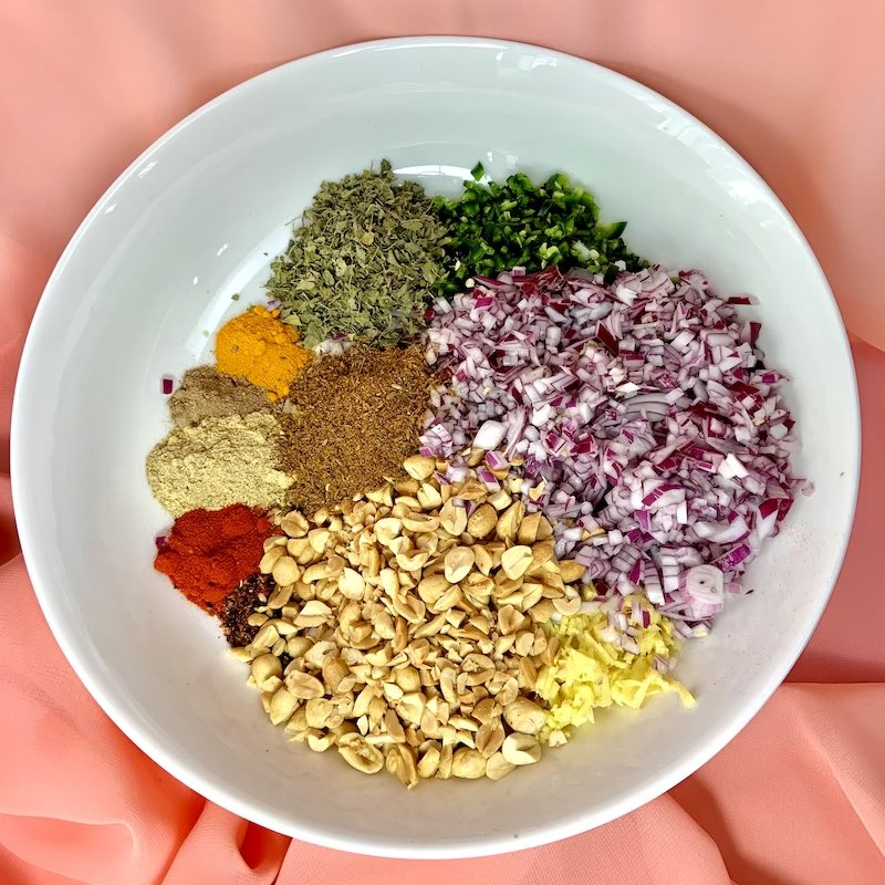 spices and other chopped ingredients in white bowl