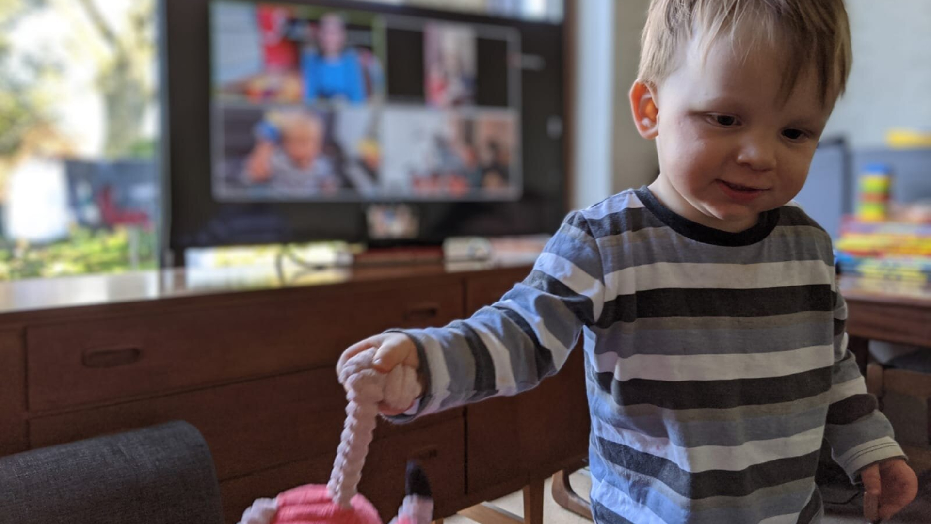 Photo of a boy holding a toy