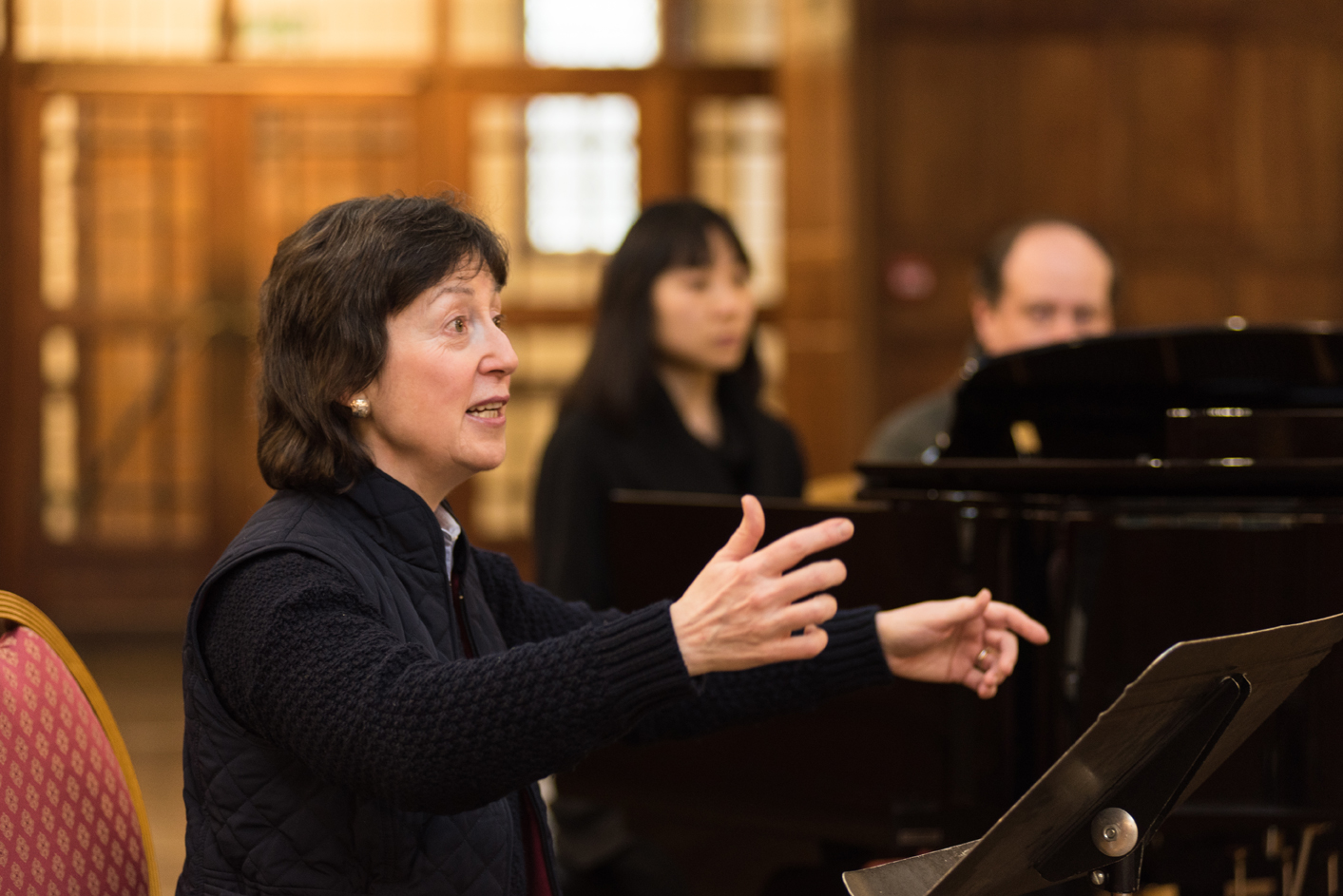 Denise Ham conducting an orchestra