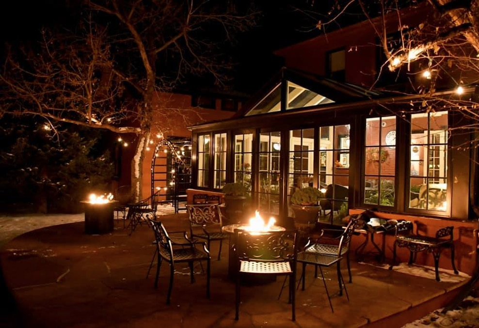 Relaxing by the firepit at the Chamberlin inn boutique hotel