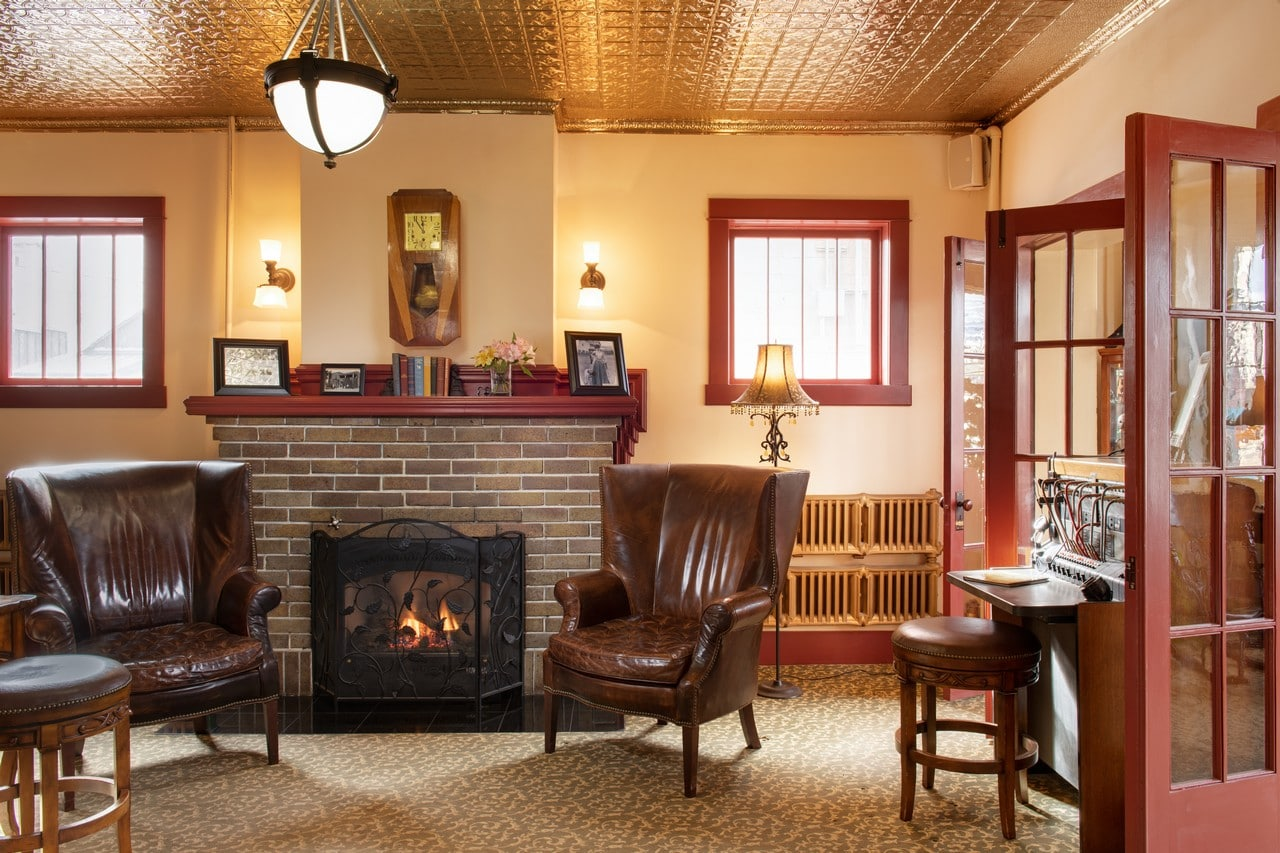 Relax by the fireplace in the lobby of the Chamberlin inn