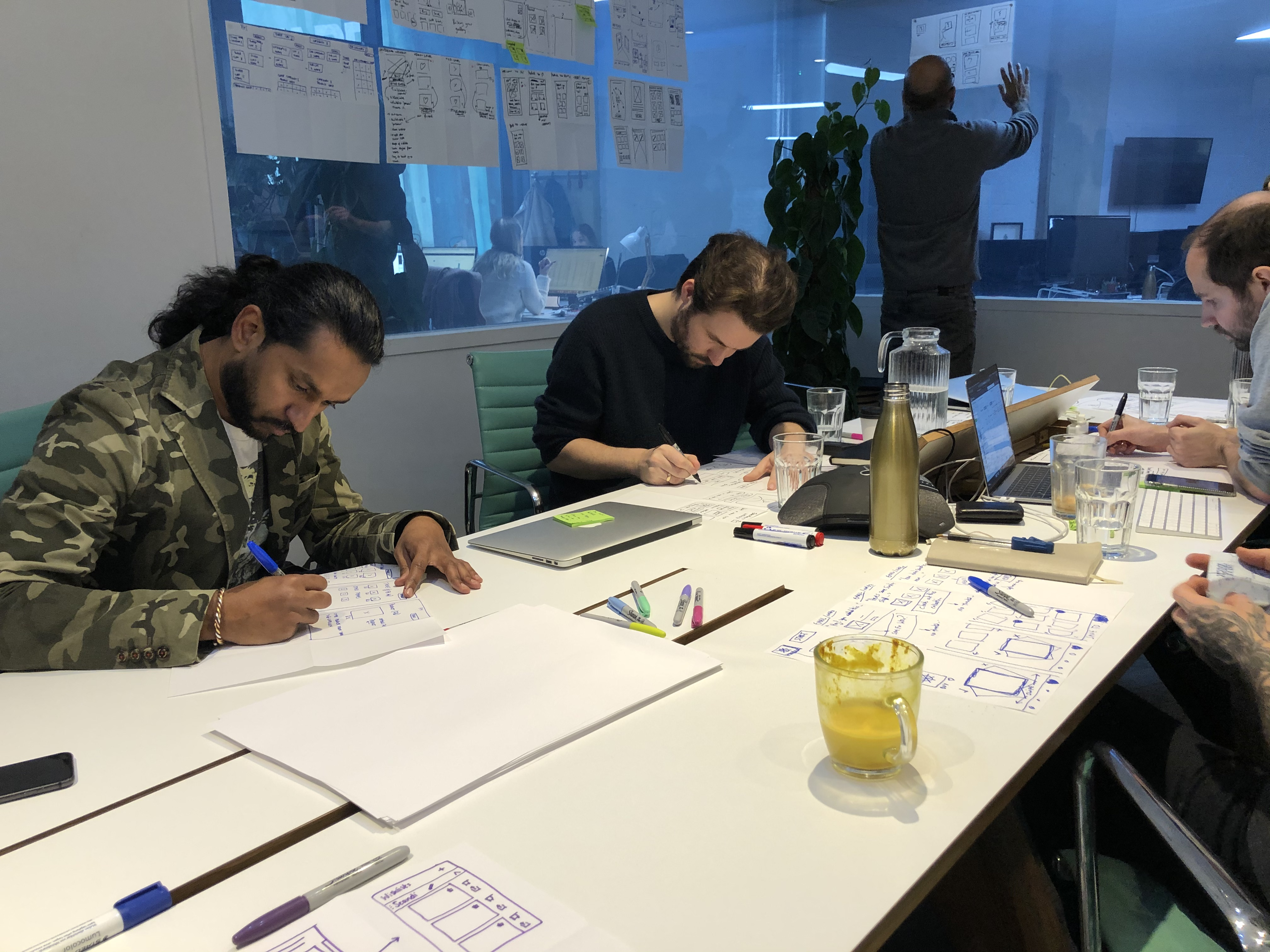 Founders from Fy are sketching their crazy 8's ideas during the design sprint
