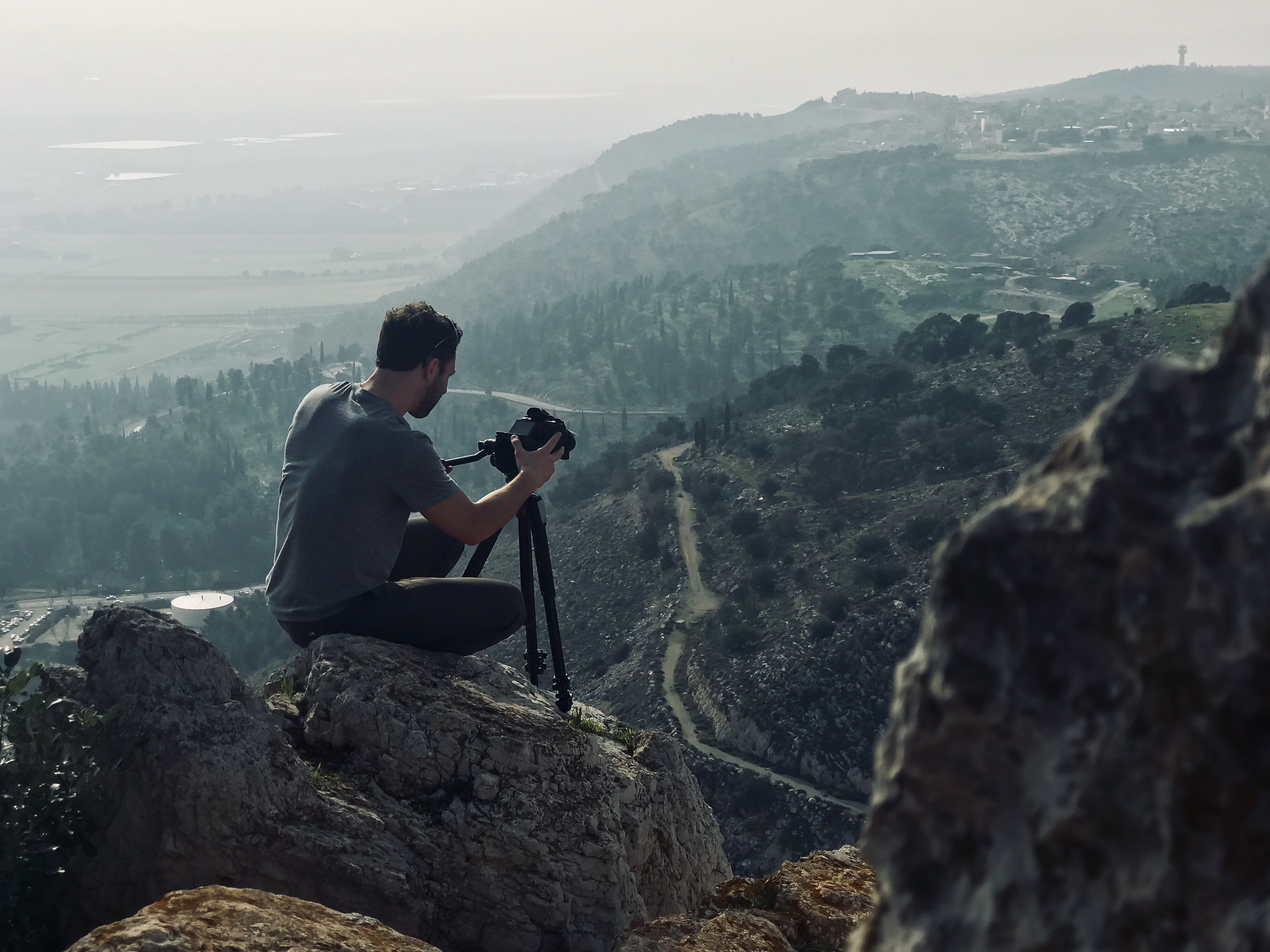 Photographer setting up for a shot over the mountains