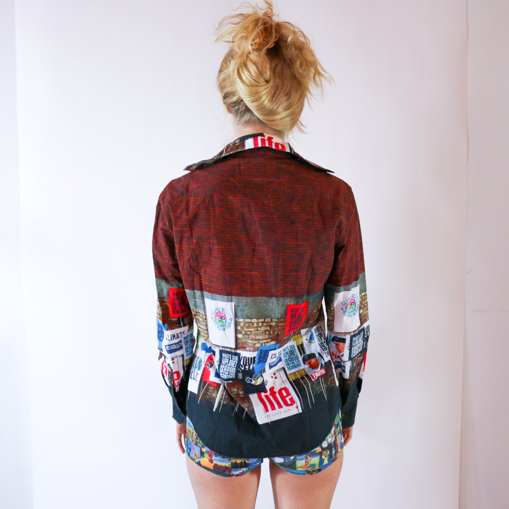 """Wear the climate protest on your top with this wonderful Vivienne Westwood number. """"Climate Revolution"""" is more than just a print for her clothes: Westwood has an on-going blog (https://climaterevolution.co.uk/) where you can find documentation on her activism."""