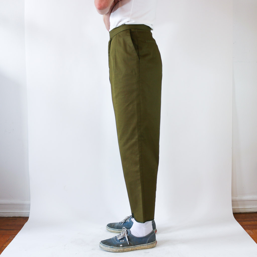 These gorgeous pants are not your typical trouser. They feature an adorable scallop hem with a big pleat in the back. Wear them mid-rise with a shirt tucked in to show them off.