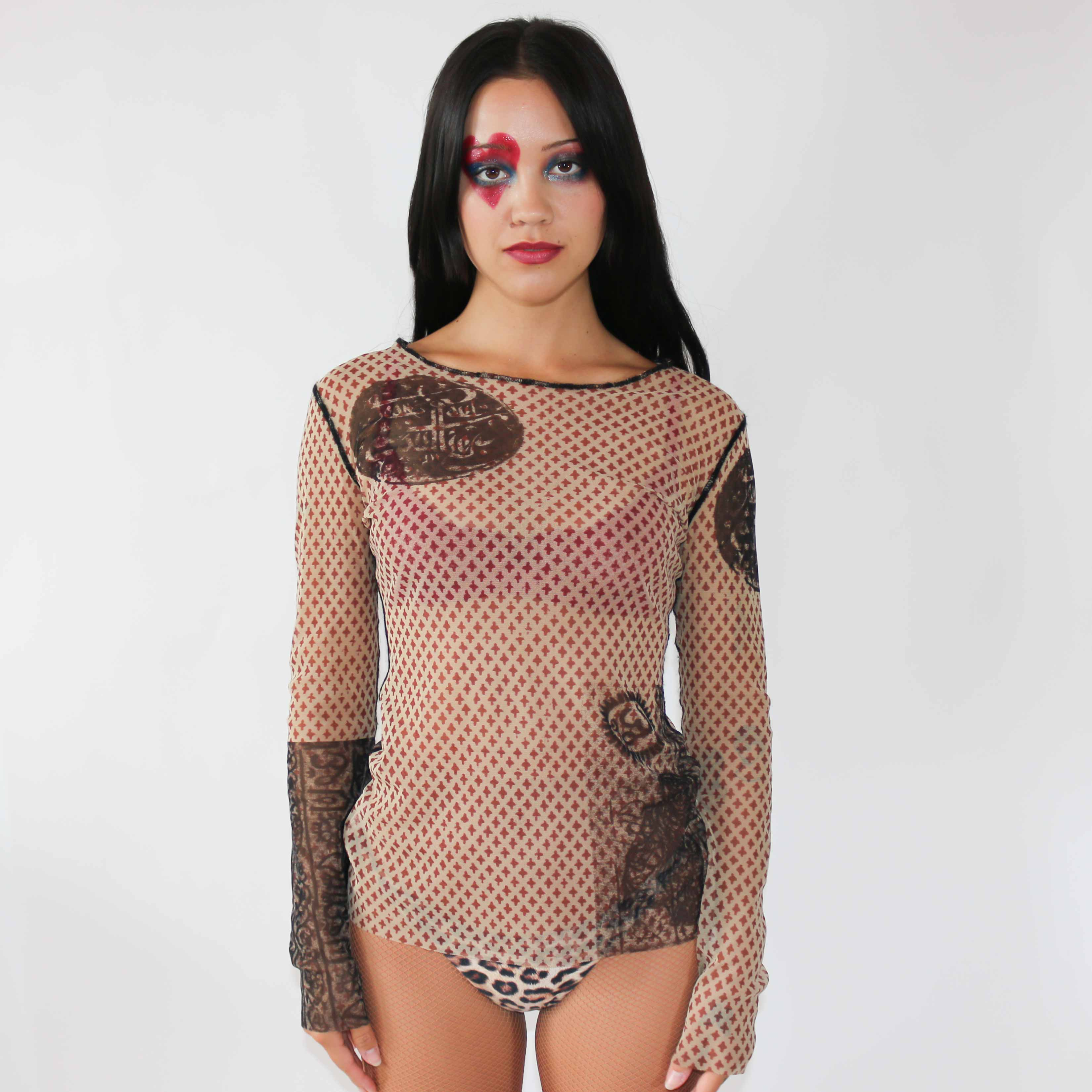 Only a few ever made, this super rare mesh top is a collectable. And not to brag but a little bridie told me Kim Kardashian has the exact same one.