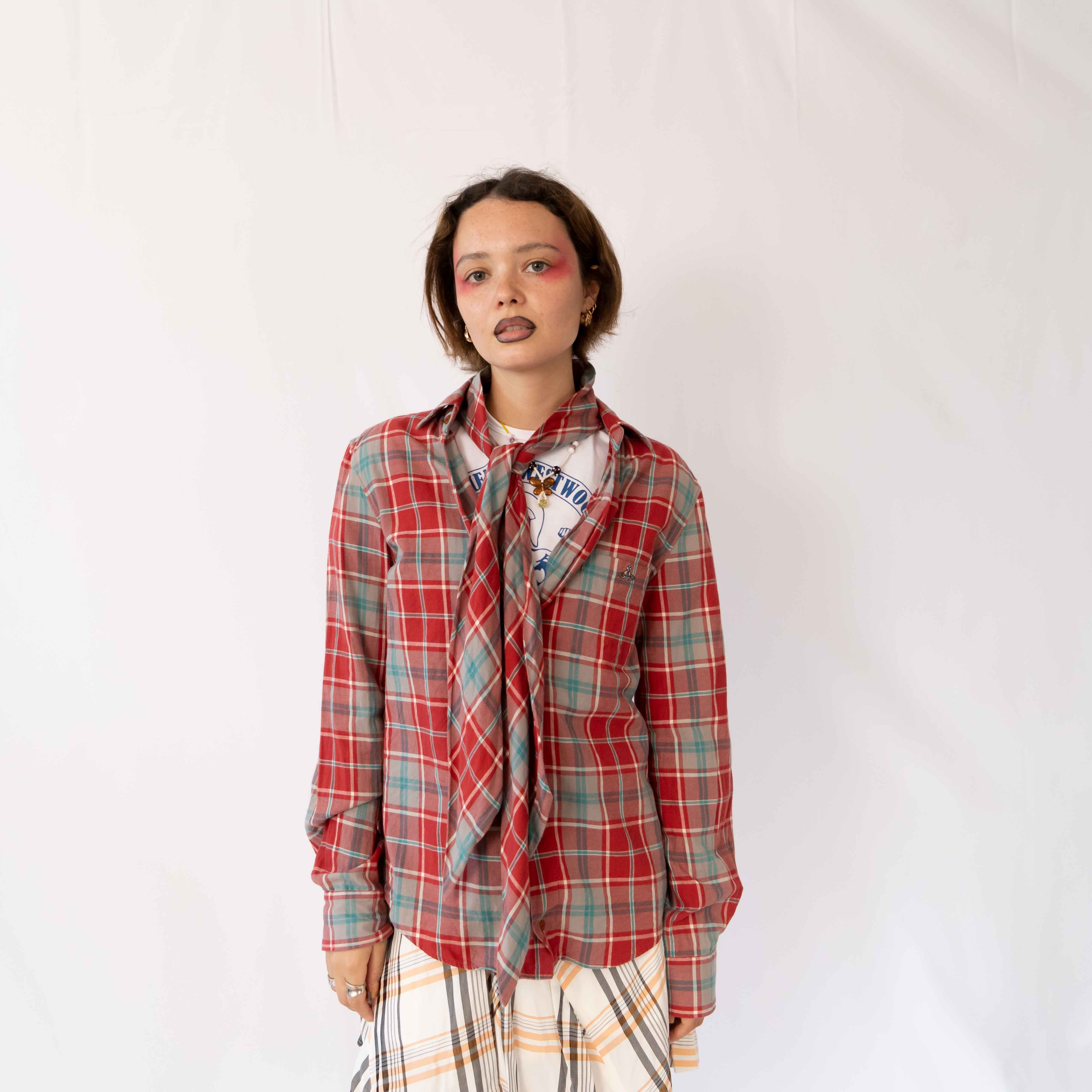 Flannel season is approaching... and what better way to bang it out than with a Vivienne Westwood one. This piece features an attached neck tie that you can make into big bow or let it hang loose.