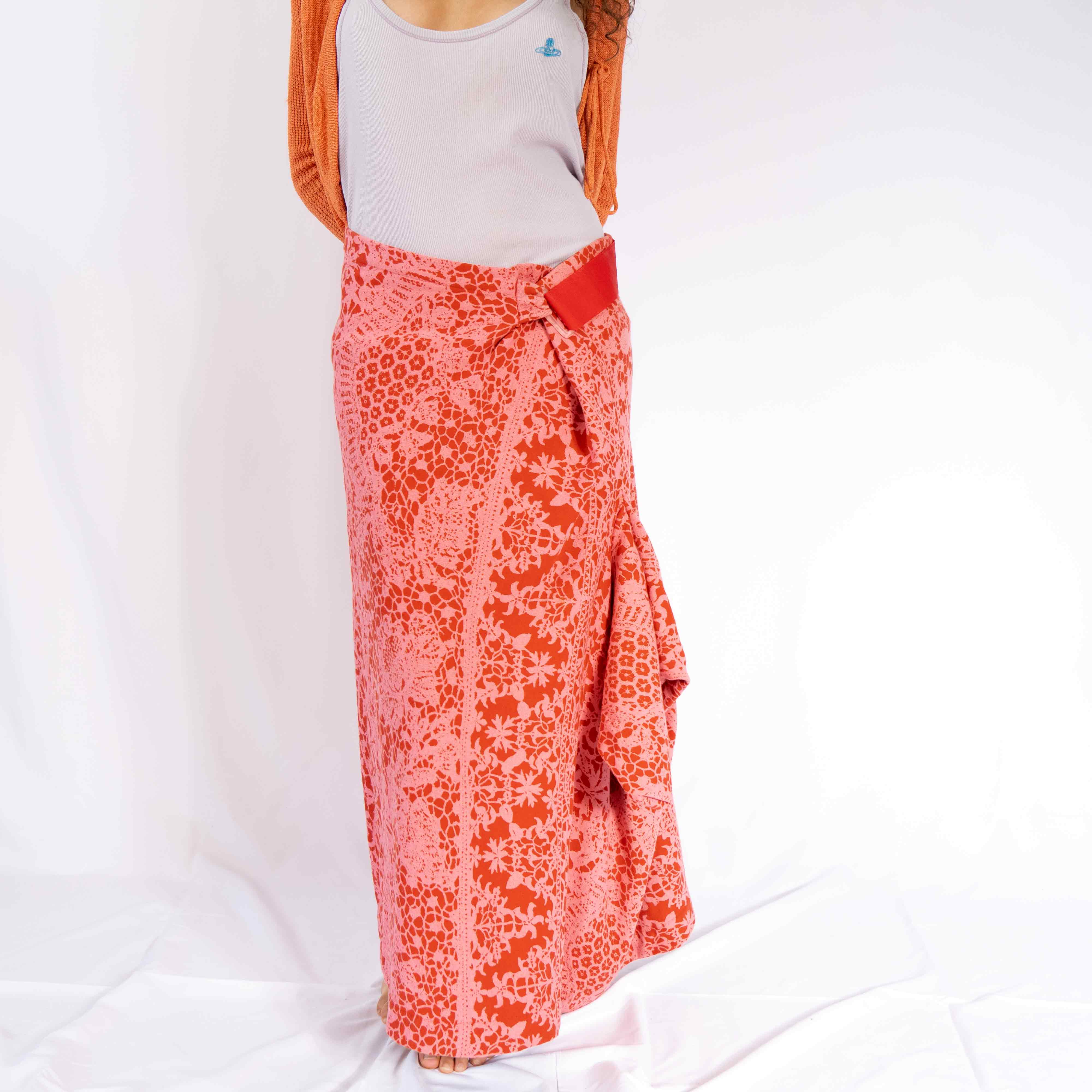 Tap into your inner beach babe with this epic long skirt. It features a velcro closure that allows you to wear it high or low waist.