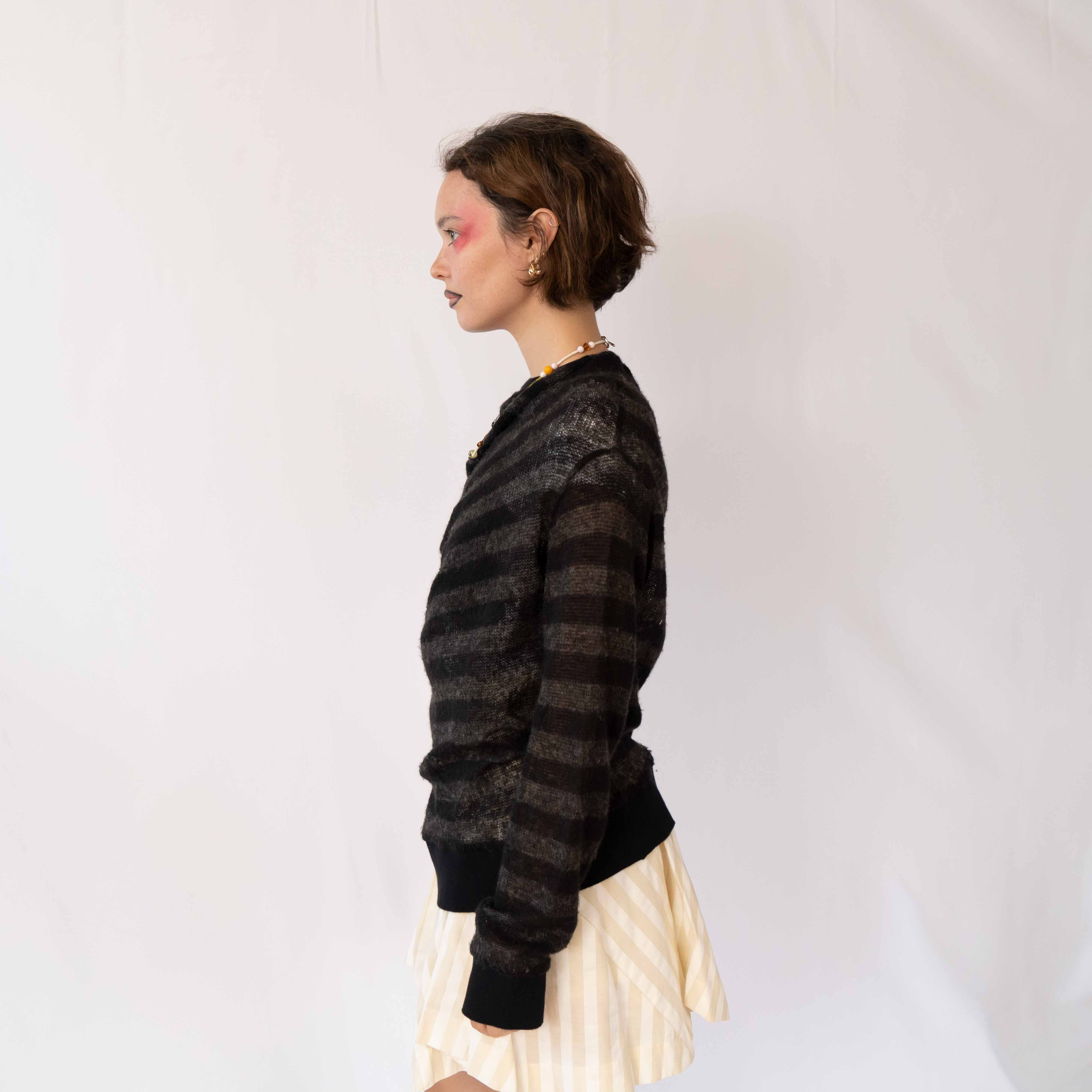 The perfectly imperfect mohair sweater. It's one of those pieces that only make sense when you try it on... and once you do, you fall in love.