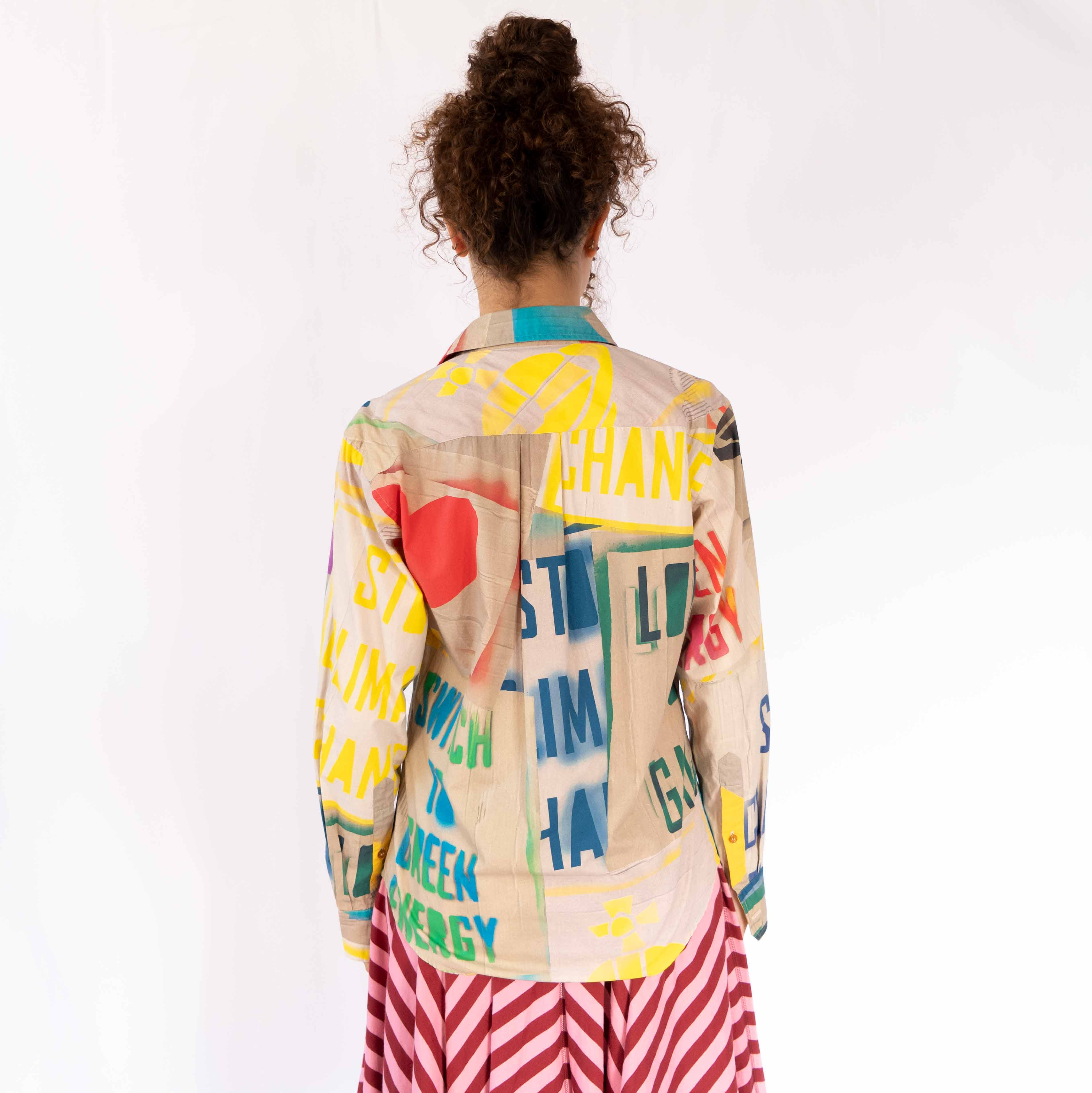 The coolest button up we've seen in a long time. This graphic shirt pairs perfectly with a sexy skirt or a pair of slacks.