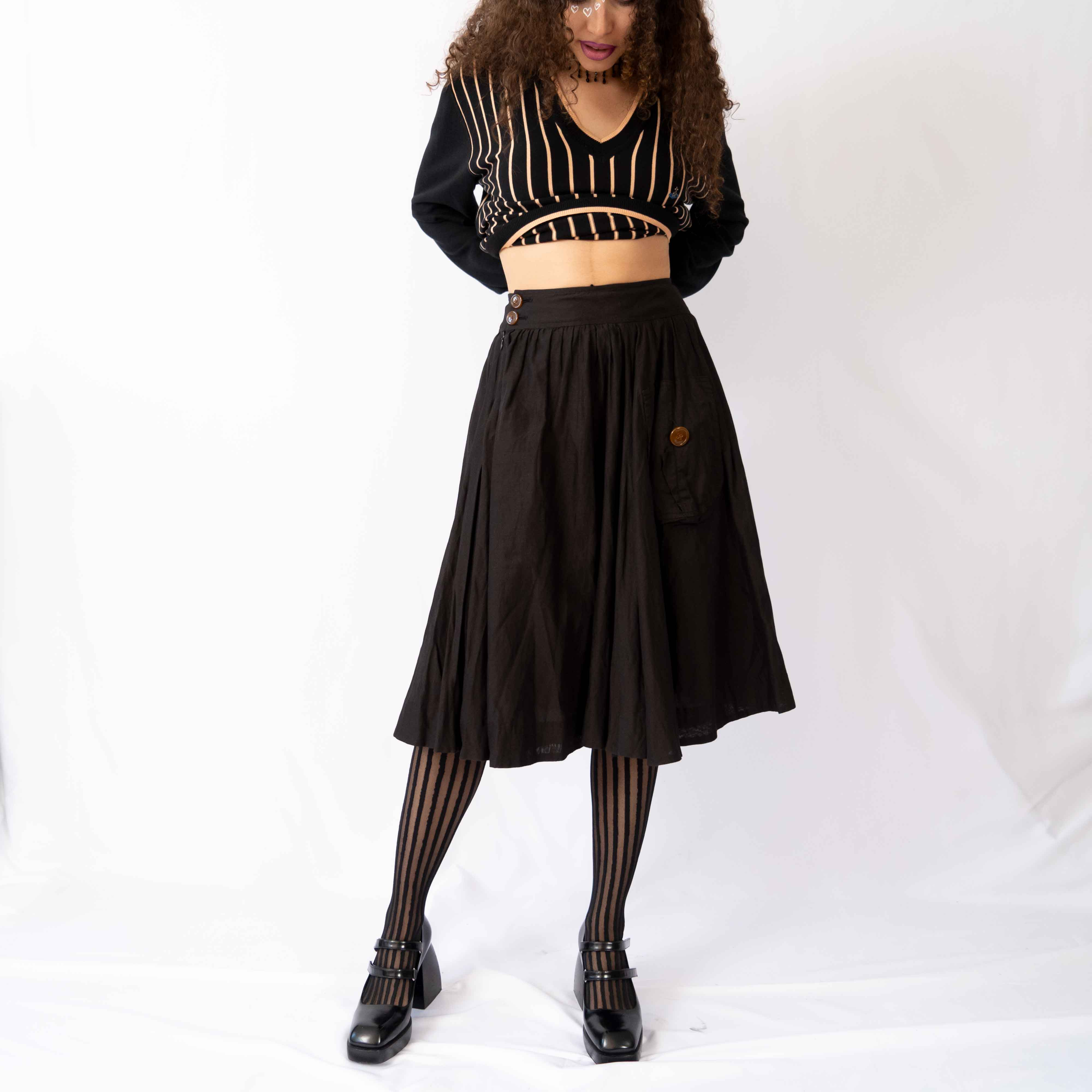 Easy, breezy, and beautiful. This linen midi skirt is great for summer or winter.