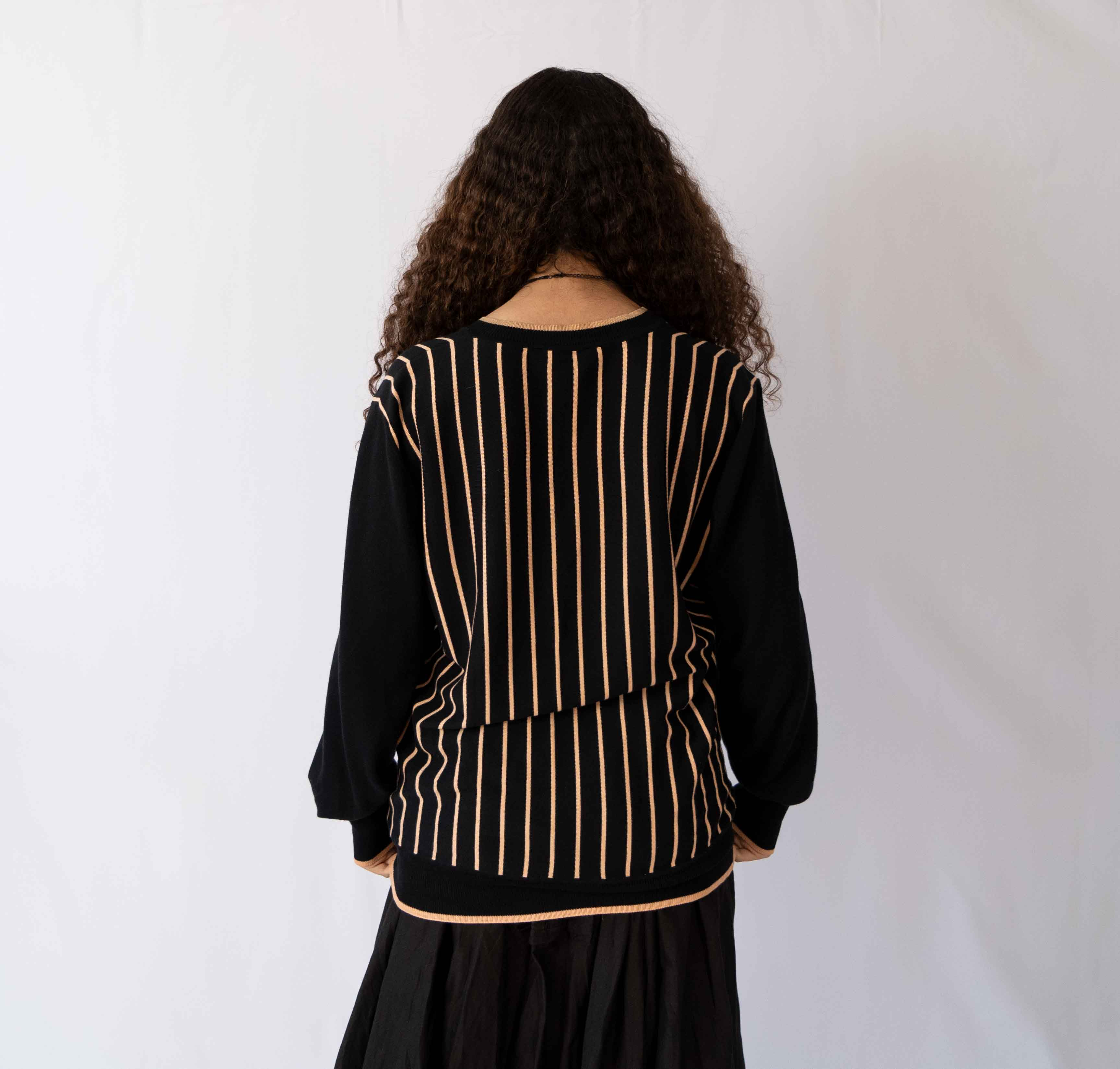A pinstripe sweater with a nice big v-neck, perfect. Wear it oversized or fit it just right.