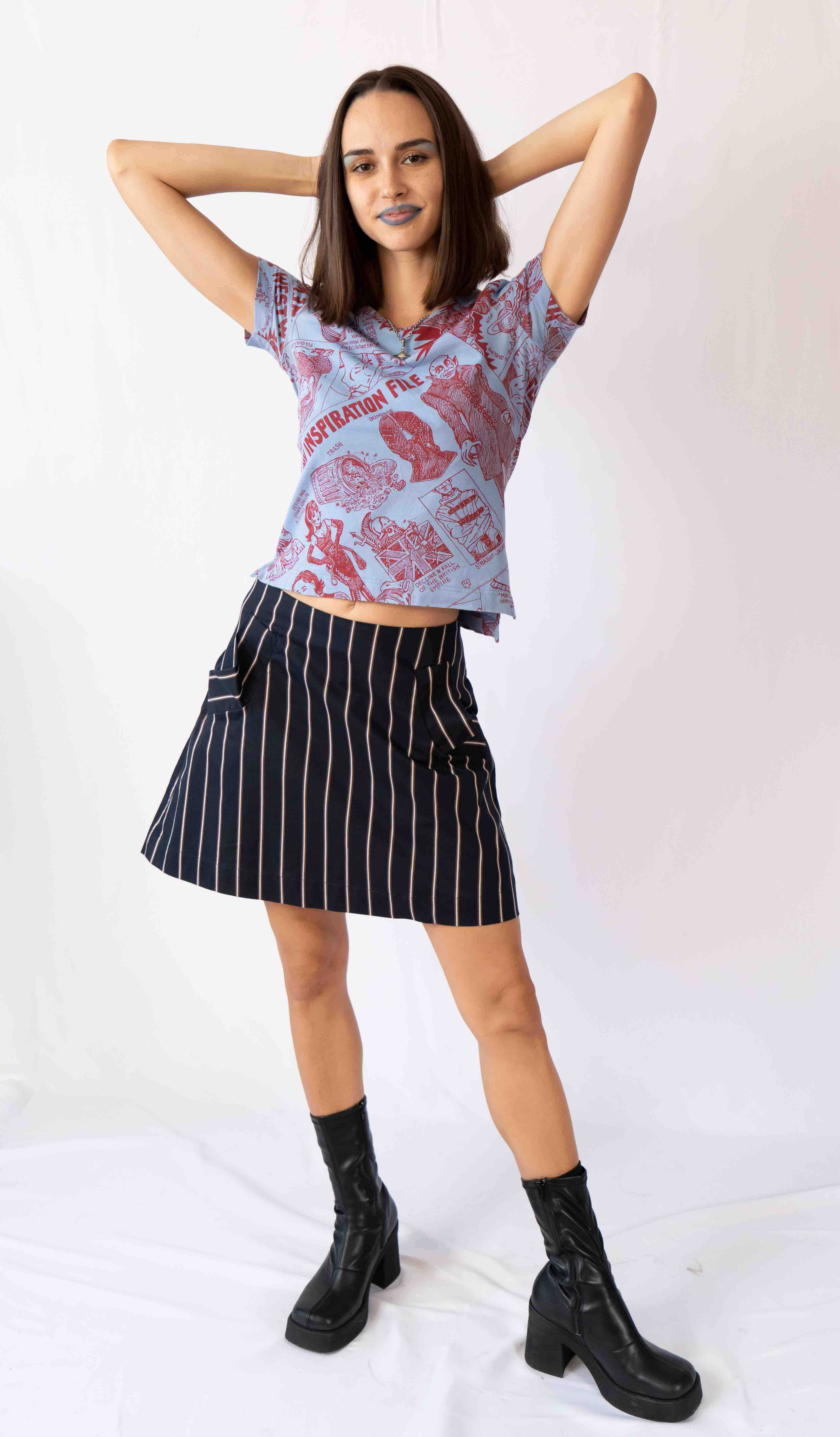 This is one of those skirts that make no sense on the hanger but look amazing on. This cool skirt lays perfectly on the body with the detached extra button closure. Perfect for a fall evening.
