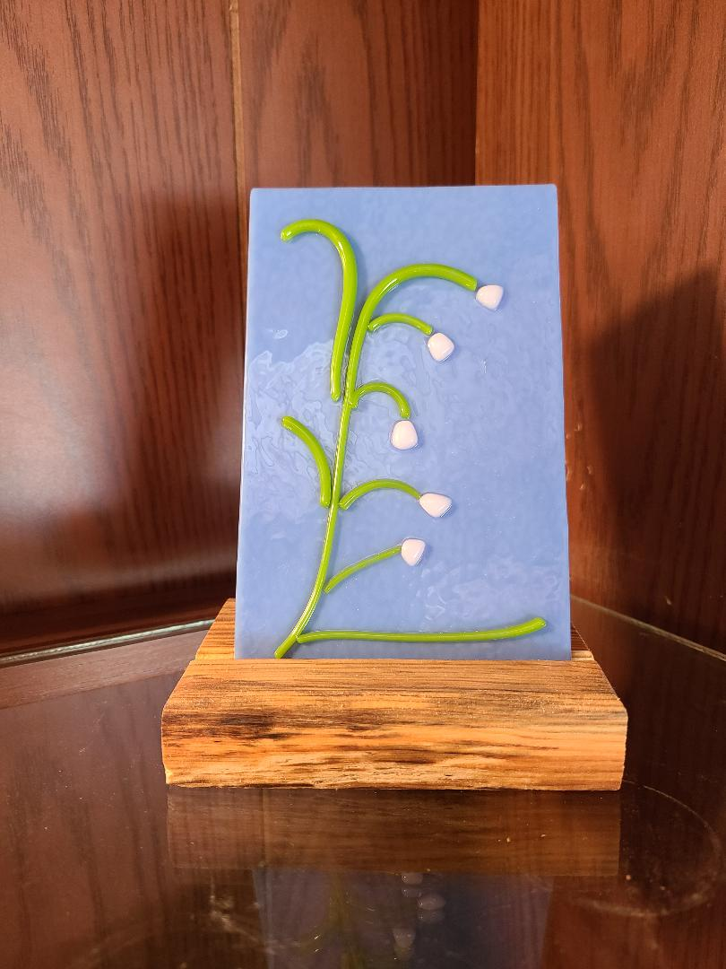 Lilies of the Valley on blue