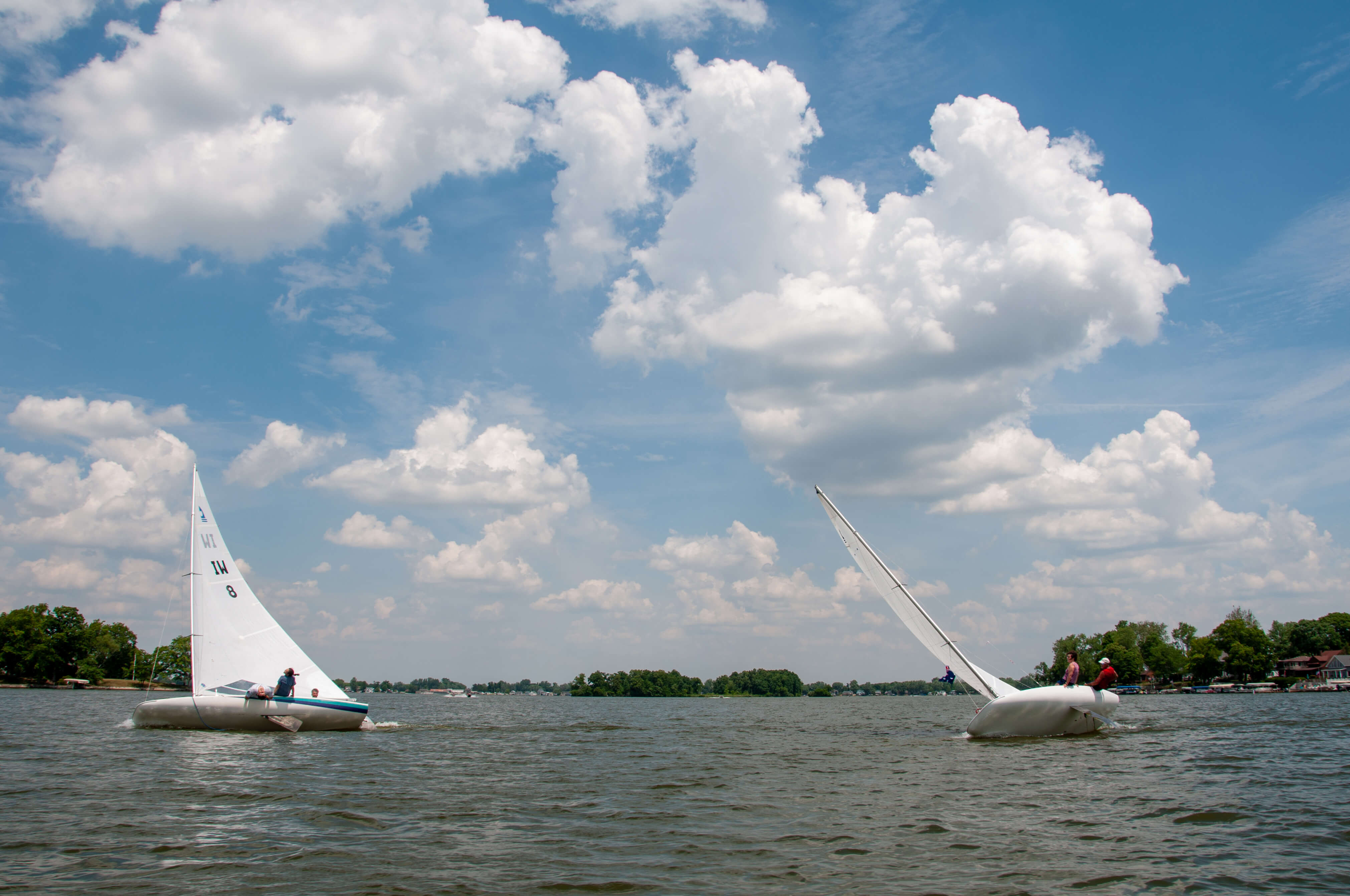 Two sailboats on a lake